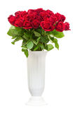 Bouquet from red roses in vase isolated on white background. Royalty Free Stock Images