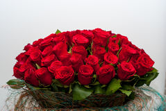 Bouquet of red roses on a wall background Royalty Free Stock Image