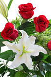 Bouquet of red roses and white lily. Bouquet of beautiful red roses and white lily, on white background Stock Images