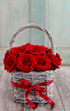 Bouquet of red roses in wicker basket Stock Photography