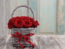Bouquet of red roses in wicker basket Stock Image
