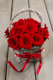 Bouquet of red roses in wicker basket Stock Photo