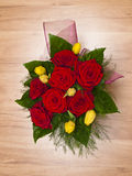 Bouquet of red roses and yellow tulips Stock Image