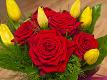 Bouquet of red roses and yellow tulips Royalty Free Stock Image
