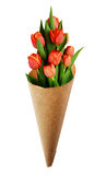 Bouquet of red tulip flowers in a craft paper cornet Royalty Free Stock Images