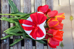 Bouquet of red tulip flowers and gift box Royalty Free Stock Photo