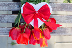 Bouquet of red tulip flowers and gift box Royalty Free Stock Images