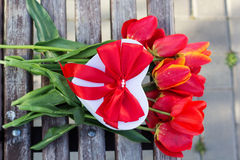 Bouquet of red tulip flowers and gift box Royalty Free Stock Photos