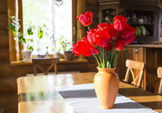 Bouquet of red tulips. Red tulips in a ceramic vase on the table. interior stock image