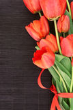 Bouquet of red tulips on dark background with space for text Stock Photography