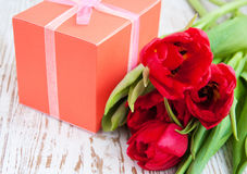 Bouquet of  tulips, gift box on a table Royalty Free Stock Photography