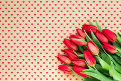 Bouquet of red tulips on hearts background. Copy space, Royalty Free Stock Photography