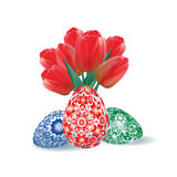 Bouquet of red tulips and set of Easter eggs Stock Photo