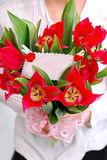 Bouquet of red tulips with ticket for message Stock Images