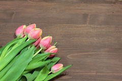 Bouquet of red tulips. On a wooden background Stock Photo
