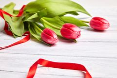 Bouquet of red tulips on a wooden background. stock photo