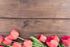 Bouquet of red tulips on a wooden background with space for text Royalty Free Stock Images