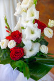 A bouquet of red and white roses and gladiolus. Stock Photos