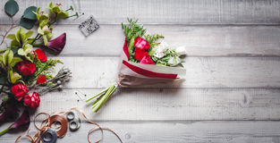 Bouquet of red and white roses, hearts, callas, carnations and ribbons on table Stock Photos