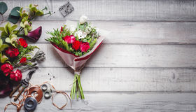 Bouquet of red and white roses, hearts, callas, carnations and ribbons on table Royalty Free Stock Image