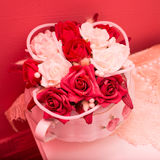 Bouquet of red and white roses in the vase on the table Royalty Free Stock Photo