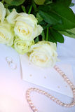 Bouquet, rings and card. Royalty Free Stock Image