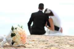 Bouquet with romantic couple in the background Royalty Free Stock Photo