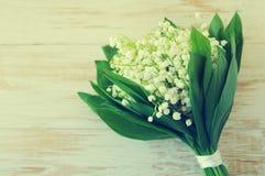 Bouquet romantique avec des lis de ressort de la vallée Image stock