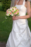 Bouquet from rose. Bride Holding Bouquet from rose - pinkly yellow Royalty Free Stock Photo