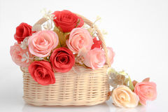Bouquet of Rose flowers. In basket, isolated on white Stock Photography