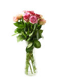 Bouquet of rose flowers isolated. Bouquet of rose flowers in a glass vase, composition isolated over the white background Royalty Free Stock Image