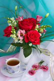 Bouquet of roses. Bouquet of red roses on a turquoise backgraund Stock Photography