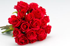 Bouquet of roses. Bouquet of artificial red roses, isolated, space for copy in the side Stock Images