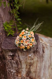 Bouquet of roses. On a tree stump Royalty Free Stock Photos