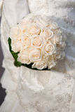 Bouquet of roses. Bouquet of white roses on white dress Royalty Free Stock Images