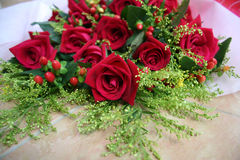 Bouquet of roses. Wrapped in white & red Royalty Free Stock Photo