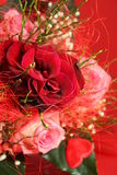 Bouquet of roses. Bunch of  roses on a red background Stock Photo
