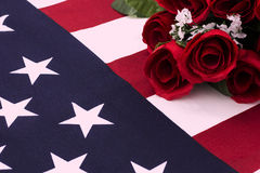 Bouquet of roses on American flag - close up Royalty Free Stock Images