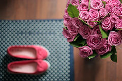 A bouquet of roses as a gift on Valentines Day. Bouquet of pink roses as a gift for Valentines day on a background of pink ballet shoes Stock Image