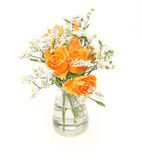 Bouquet of roses and babys breath in a glass bottle Stock Images