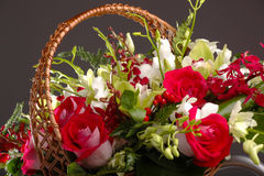 Bouquet of roses in a basket with decoration Stock Images