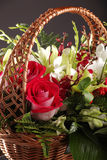 Bouquet of roses in a basket with decoration Stock Image