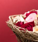 Bouquet Roses in Basket on Red Royalty Free Stock Photos
