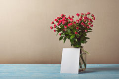 Bouquet of roses with a blank greeting card Royalty Free Stock Photo