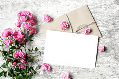 Bouquet of roses with a blank greeting card and envelope Stock Images
