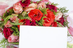 Bouquet of roses with blank note card Stock Photo