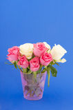Bouquet roses on blue Royalty Free Stock Images