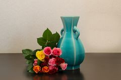 Bouquet of roses and the blue vase. Pictured a bouquet of roses and the blue vase royalty free stock photos