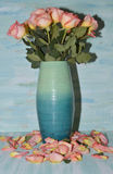 Bouquet of roses in blue vase Royalty Free Stock Images