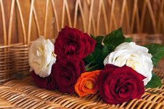 Bouquet of roses. Bouquet of colorful roses on straw background stock photography